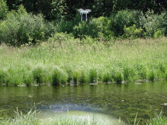 A drone flies over a spring in Fitchburg, Wis. as the project to evaluate groundwater continues.