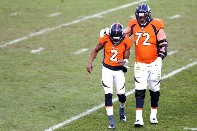 Kendall Hinton, a receiver on Denver's practice squad, was starting QB for a day last Sunday. It didn't go well, which explains why lineman Garett Bolles is offering consolation as they leave the field following an interception.