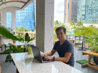 In this photo provided by Ashley McCue, Richard Matsui works from a coworking space on Nov. 18, 2020, in Honolulu. A group of Hawaii leaders is trying to attract more people like Matsui to work remotely in Hawaii during the pandemic.