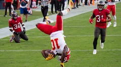 Kansas City Chiefs wide receiver Tyreek Hill (10) does a back flip into the end zone to score a touchdown against the Tampa Bay Buccaneers during an NFL football game, Sunday, Nov. 29, 2020, in Tampa, Fla.
