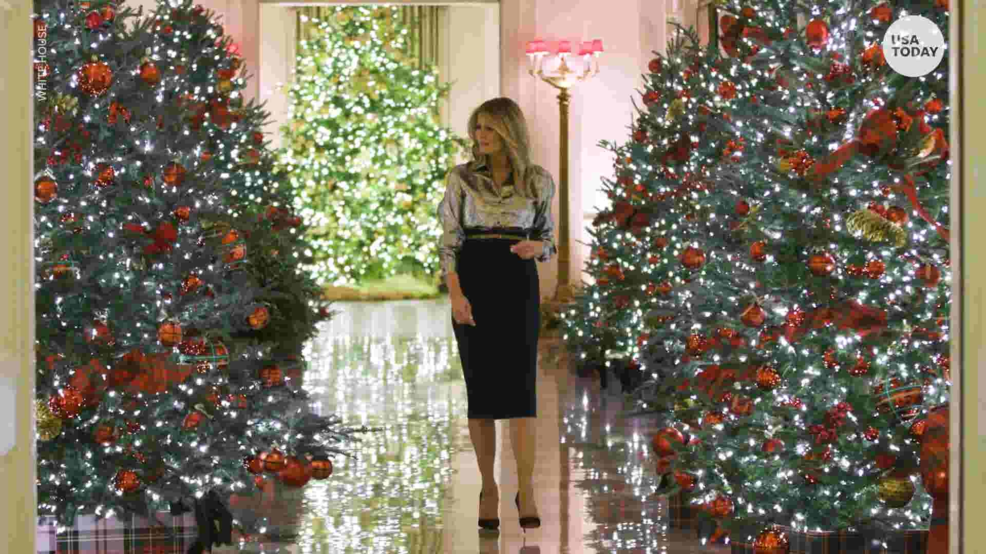 First lady unveils White House Christmas decorations after controversy