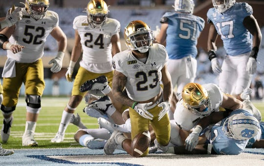 Notre Dame's Kyren Williams (23) reacts after scoring a touchdown against North Carolina at Kenan Stadium in Chapel Hill, N.C.