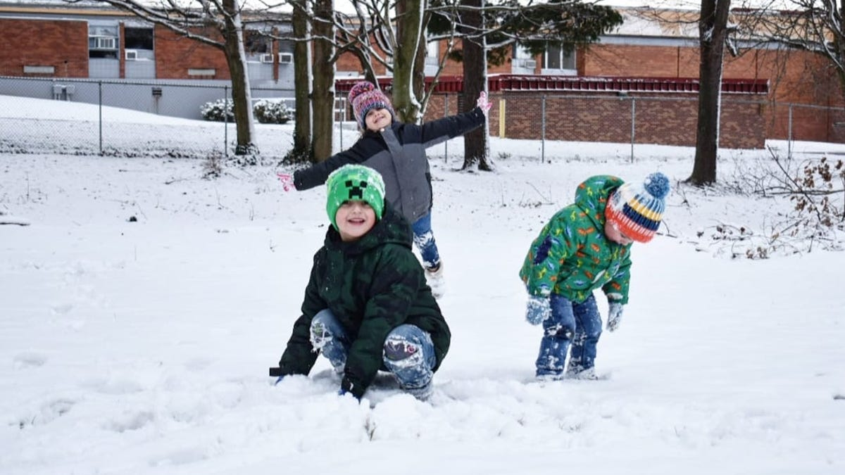 Kids, pets play on a snowy day around Ohio