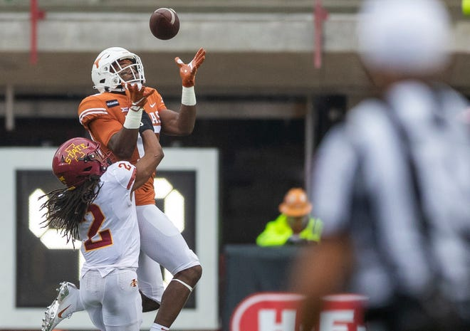 Texas Longhorns wide receiver Brennan Eagles (13) pulls the ball in for a first down against Iowa State Cyclones defensive end JaQuan Bailey (3) in the first quarter during NCAA college football game on Saturday, November 27, 2020; Austin, Texas, at Darrell K Royal-Texas Memorial Stadium. [RICARDO B. BRAZZIELL/AMERICAN-STATESMAN]