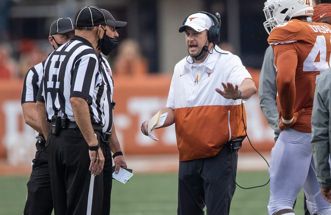 Texas Longhorns head coach Tom Herman speak with the officials during a timeout against Iowa State Cyclones during NCAA college football game on Saturday, November 27, 2020; Austin, Texas, at Darrell K Royal-Texas Memorial Stadium. [RICARDO B. BRAZZIELL/AMERICAN-STATESMAN]