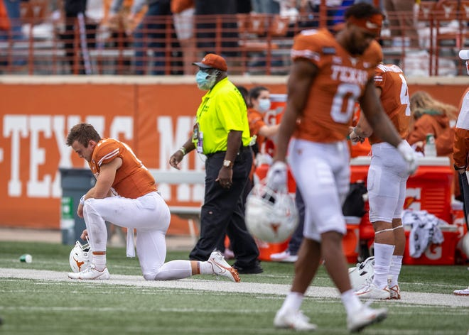 Texas Longhorns quarterback Sam Ehlinger (11) looks down after watching Texas Longhorns place kicker Cameron Dicker (17) miss a field goal that would have sent the game into overtime against Iowa State Cyclones during an NCAA college football game on Saturday, November 27, 2020; Austin, Texas, at Darrell K Royal-Texas Memorial Stadium. Iowa State Cyclones beat Texas Longhorns 23-20