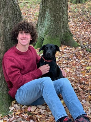 Loudonville High School senior soccer player Trevor Portz, shown here with his pet dog Jasmine, was named second team all Ohio in Division III.