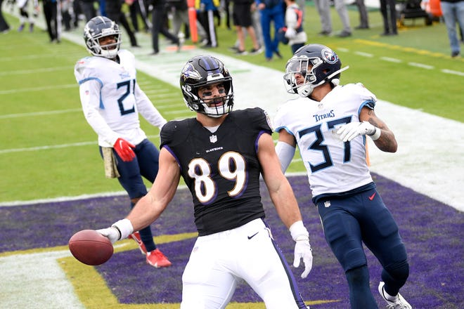 Baltimore Ravens tight end Mark Andrews (89) reacts after scoring on a touchdown pass from quarterback Lamar Jackson, not visible, during the second half of an NFL football game against the Tennessee Titans on Nov. 22 in Baltimore. Titans' Amani Hooker (37) and Malcolm Butler (21) look on.