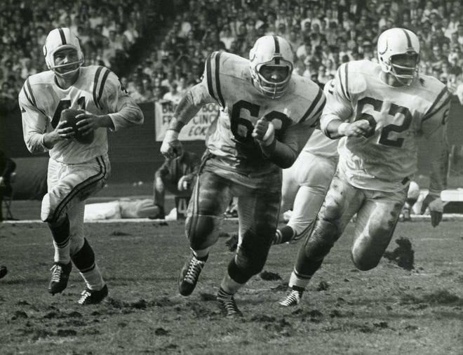 Running back Tom Matte, here following Baltimore Colts linemen Alex Sandusky (68) and Palmer Pyle, was used by coach Don Shula as an emergency QB late in the 1965 season after injuries to Johnny Unitas and Gary Cuozzo. Matte had played some quarterback for Woody Hayes at Ohio State in 1959 and '60.
