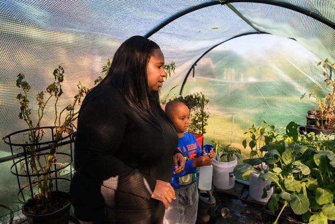 Enjoli Dixon enjoys sharing her love of gardening with her sons. For two years, Dixon dealt with facial pain caused by a nerve condition called trigeminal neuralgia. After surgery at MU Health Care, Dixon is now pain-free