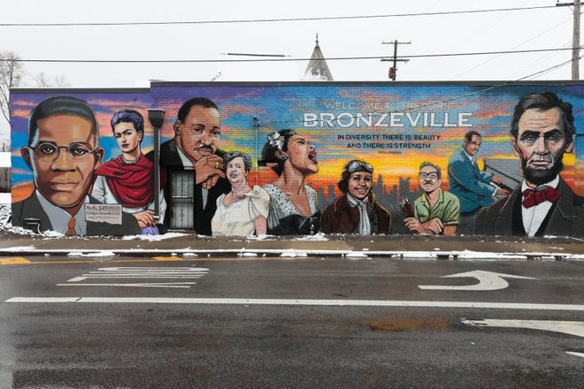 The Bronzeville mural, painted by artist Gabriel Gatton, adorns the side of a building along Governors Place near Long Street in Columbus.