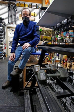 Andy Demain, co-owner of the Play It Again Sports on Sawmill Road, said some exercise gear, including weights, has been in huge demand during the COVID-19 pandemic.