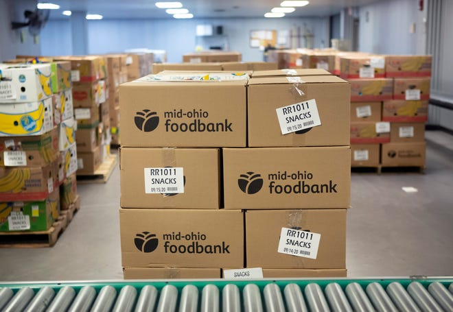 Boxes of food await distribution at the Mid-Ohio Foodbank in Grove City on Tuesday, Dec. 1, 2020. The Foodbank is using $500,000 in CARES Act funding to support food assistance during the holiday season.