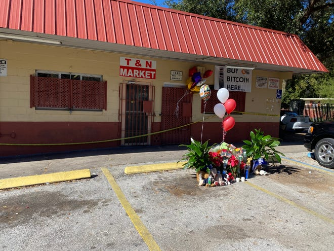 Mourners create makeshift memorial outside market on Grand View Street.
