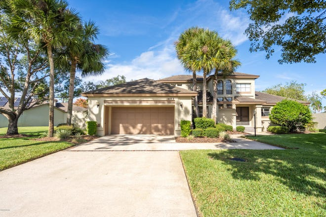 This gorgeous pool home in the extremely sought-after Spruce Creek Fly-In community has great water and golf-course views.