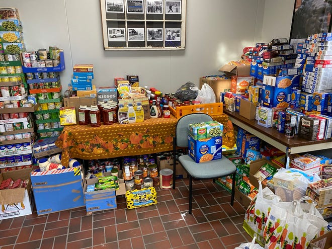 Donations to the Greencastle Police Department's 10 Most Wanted food roundup covered tables, chairs and the floor of the lobby before being delivered to the Greencastle-Antrim Food Pantry.
