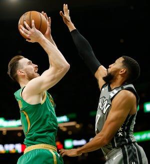 Boston Celtics guard Gordon Hayward (20) shoots defended by Brooklyn Nets guard Garrett Temple (17) during the first half at TD Garden.