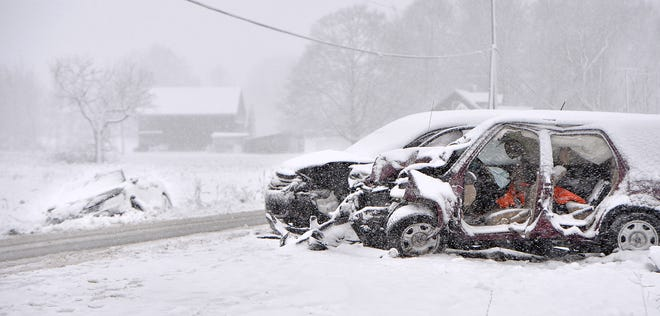 Three of four vehicles involved in an early-morning accident Tuesday await removal near the intersection of Route 18 and Richardson Road in Elk Creek Township. Pennsylvania State Police reported two separate accidents at the scene.
