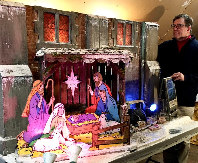Michael DeSanctis applies finishing touches to his newest Nativity scene handmade in his attic studio in Erie. The Nativity is on display in the sanctuary of the First Presbyterian Church of the Covenant, 250 W. Seventh St.  DeSanctis was a professor of fine arts and theology at Gannon University for more than 30 years.