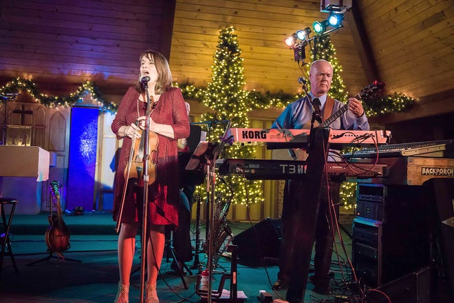 "Julie and Chris Moore perform during Tennessee Backporch's ""Follow the Star"" Christmas Tour in 2017."