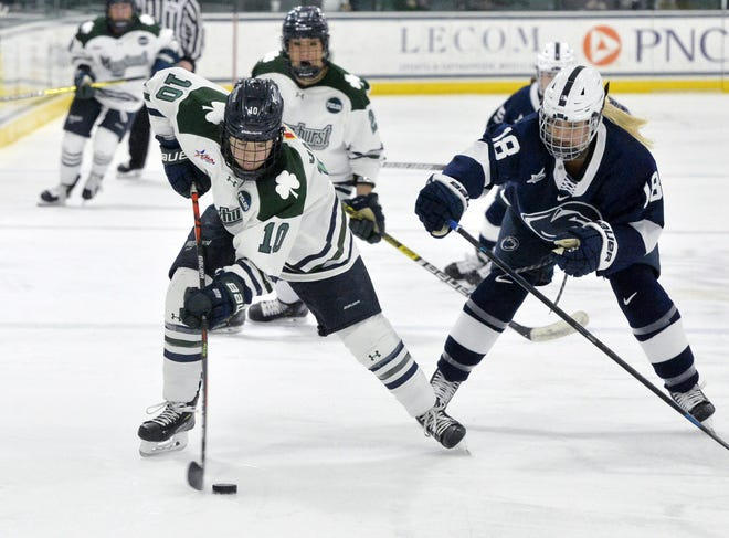 Mercyhurst's  Alexa Vasko, left, moves the puck past Penn State's Amy Dobson during a College Hockey America contest in Erie on Jan. 17. The reigning CHA champion Lakers, with Vasko as captain, open the season Saturday against RIT.