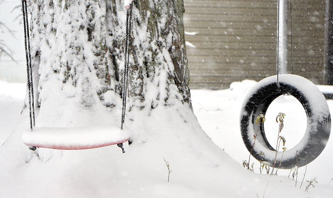 This photo from Dec. 1, shows a snow-covered swing, along Richardson Road in Elk Creek Township. The Erie region is bracing for a winter storm that may dump 12-18 inches of snow. on the area.