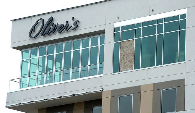 Oliver's, a restaurant on the eighth floor of the Hampton Inn at Harbor Place, 130 E. Front St., officially opened Tuesday.