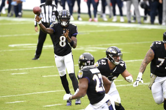 Baltimore Ravens quarterback Lamar Jackson (8) throws a pass to running back J.K. Dobbins (27) on a two-point conversion play Nov. 22 against the Tennessee Titans. The Ravens' game against the Pittsburgh Steelers has been postponed again and is now scheduled for a Wednesday afternoon kickoff. Jackson, the 2019 NFL MVP, will not play.