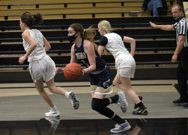 William Chrisman guard Krysta McAllister, front, moves the ball down court after grabbing a rebound in Monday's game against Savannah in the Savannah Tournament. The Bears went on to claim a 50-21 victory.