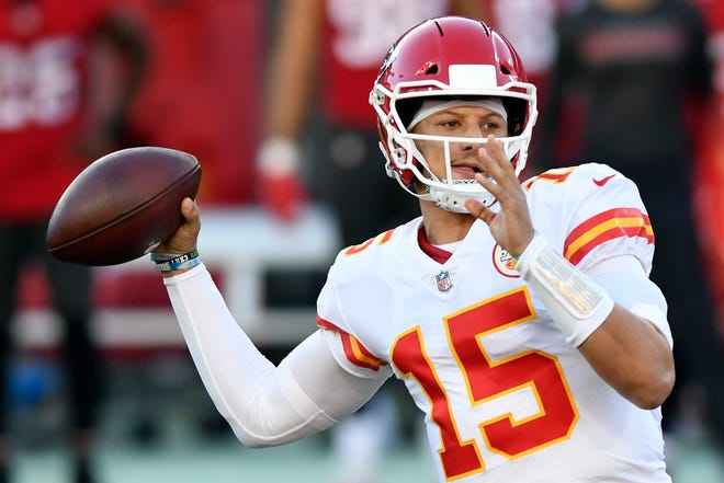 Kansas City Chiefs quarterback Patrick Mahomes (15) throws a pass against the Tampa Bay Buccaneers during the first half of Sunday's game. Mahomes maintained his assault on the record book with 462 yards passing and three touchdowns in a 27-24 win.