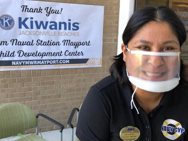 Ida Jimenez, assistant director of the Child Development Center at Naval Station Mayport, models one of the clear face masks donated to the school by Beaches Kiwanis.