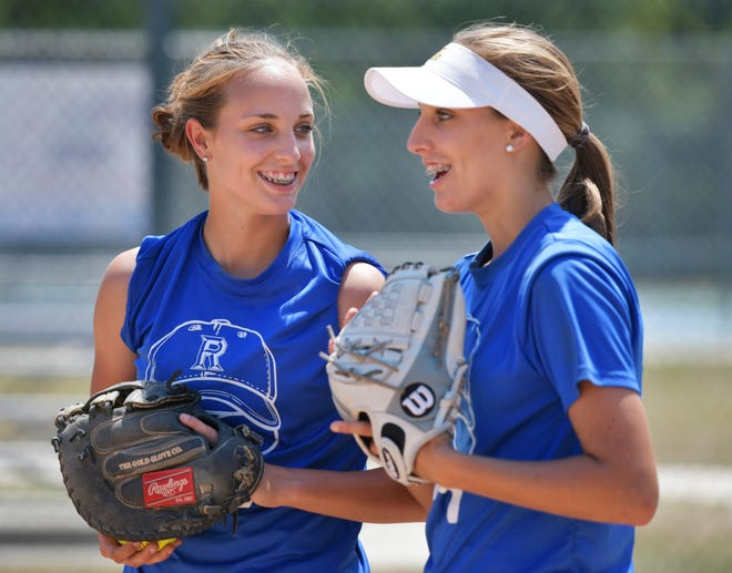 Ridgeview High softball catcher Brooke Michael (left) talks with her twin sister, pitcher Brittany Michael, during practice in 2019. Club teams across the region are participating Saturday in a softball exhibition tournament for Brooke Michael, who was diagnosed with cancer two weeks ago.