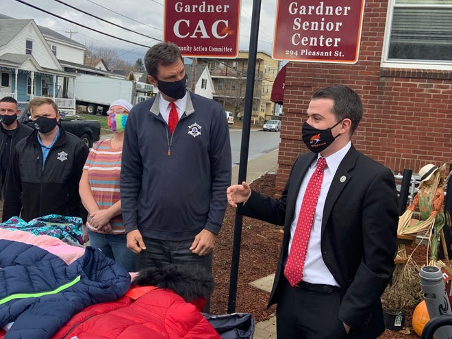 Gardner Mayor Michael Nicholson, right, thanks Worcester County Sheriff Lew Evangelidis during the first of two stops in the city on Dec. 1 as part of the sheriff's annual winter coat drive.