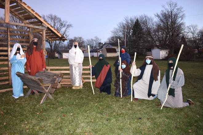 """The youth group at Mary Our Lady of Peace Catholic Church, Orion, is hosting a fundraiser called """"Journey to Joy"""" on two weekends in December. The drive-through Nativity scenes will be from 6 to 8 p.m. Fridays, Dec. 4 and Dec. 11, and 7 to 8:30 p.m. Saturdays, Dec. 5 and Dec. 12. Some of the participants are, from left, Keirah Kovac as Mary, Tyler Thomsen as Joseph, Madeline Nightingale as an angel, and Sam Nightingale, Lance Moore (standing), Carter Kincaid, Wyatt Reed and Cade Hancock."""