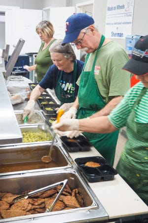 Volunteers with Meals on Wheels of Texoma prepare meals at the senior center in Sherman in 2017. The organization announced Thursday that it has received a $1.5 million donation toward the construction of a new centralized kitchen from philanthropist MacKenzie Scott.