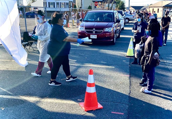 Employees of Seven Hills Behavioral Health are seen here in early November registering people for COVID-19 testing in the parking lot near the Seabra Foods supermarket on Stafford Road.