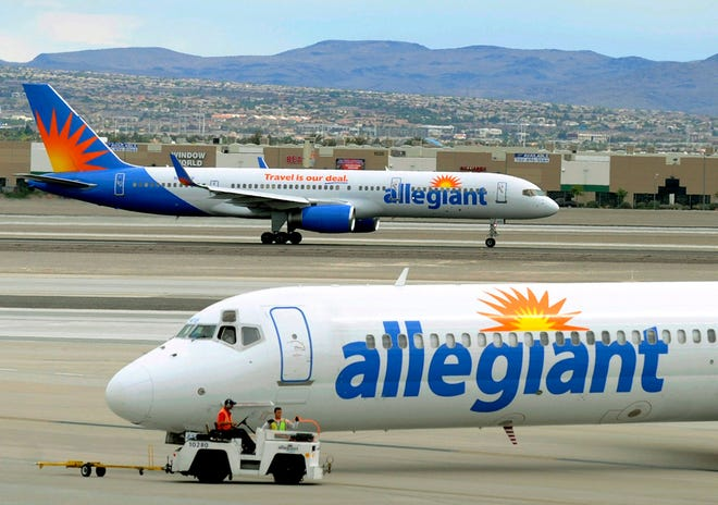 File - In this May 9, 2013, file photo, two Allegiant Air jets taxi at McCarran International Airport in Las Vegas. (AP Photo/David Becker, File)