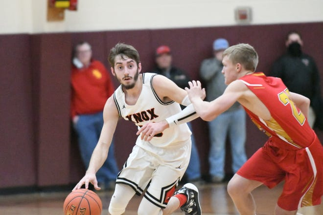 Knox County senior guard Coltin Morrow dribbles past a North Shelby defender during Monday's 62-52 win at the Tri-Rivers Classic.