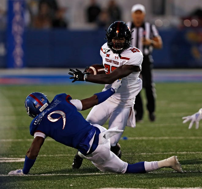 Texas Tech running back SaRodorick Thompson (28) brushes aside Kansas' Najee Stevens-McKenzie (9) during the Red Raiders' 37-34 loss last year to the Jayhawks. Tech hosts Kansas on Saturday.