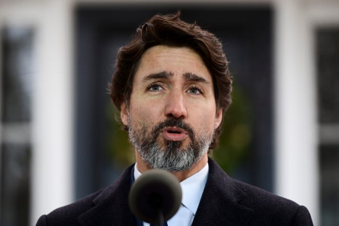 Prime Minister Justin Trudeau holds a news conference at Rideau Cottage during the COVID pandemic in Ottawa on Tuesday. Trudeau said the ban on nonessential travel with the United States will not be lifted until COVID-19 is significantly more under control around the world.
