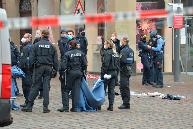 A street is blocked by the police in Trier, Germany, on Tuesday. German police said five people were killed and several others injured in the southwestern German city of Trier when a car drove into a pedestrian zone.