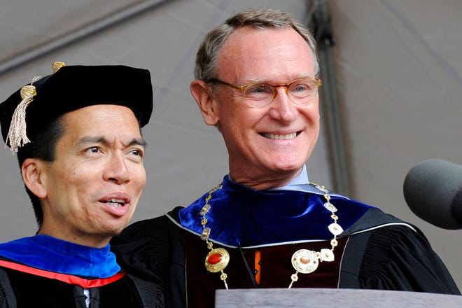 Rhode Island School of Design outgoing president Roger Mandle, right, introduces his successor John Maeda, left, during RISD's 2008 commencement in Providence, R.I.