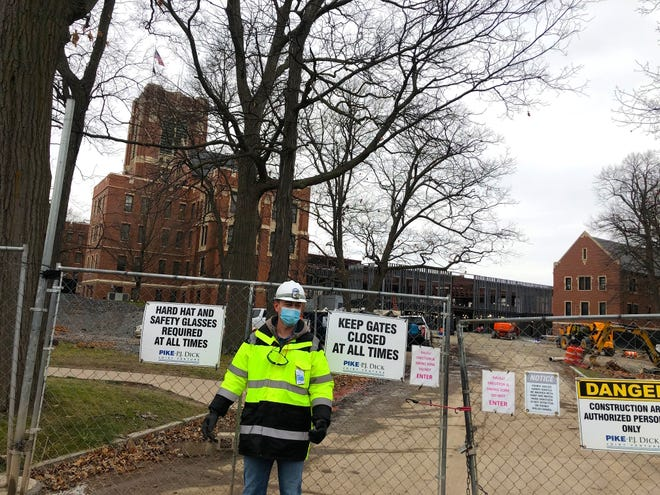 Canandaigua VA Medical Center employee Gabriel Devitt stands outside a construction gate at the VA on Wednesday, Nov. 25, where a new outpatient clinic is being built.