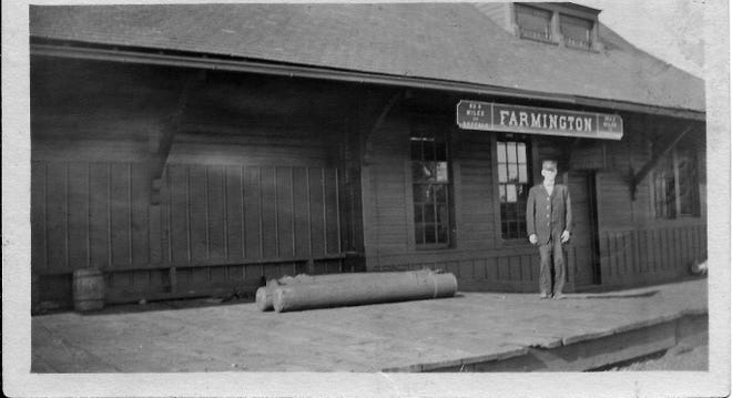 """This is the only known photograph of the Farmington railroad station that was located west of the present-day County Road 8 railroad crossing and north of the tracks. The station, originally known as """"Farmington,"""" was built in 1892 on land owned by the Tuttle family. The Farmington stop was discontinued and the station was razed in 1940."""