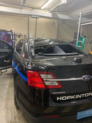 A Hopkinton police cruiser sustained heavy damage after a tree limb fell on it during Monday's stormy weather.