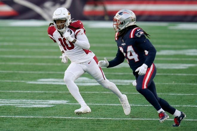 Cardinals wide receiver DeAndre Hopkins (left) runs a pass route as Patriots cornerback Stephon Gilmore defends in the second half of New England's 20-17 win over Arizona on Sunday in Foxborough.