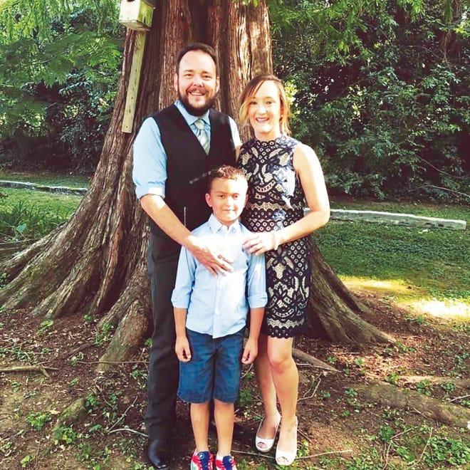 Dani Greenwell is shown with her husband, Michael, and son, Jaxon.