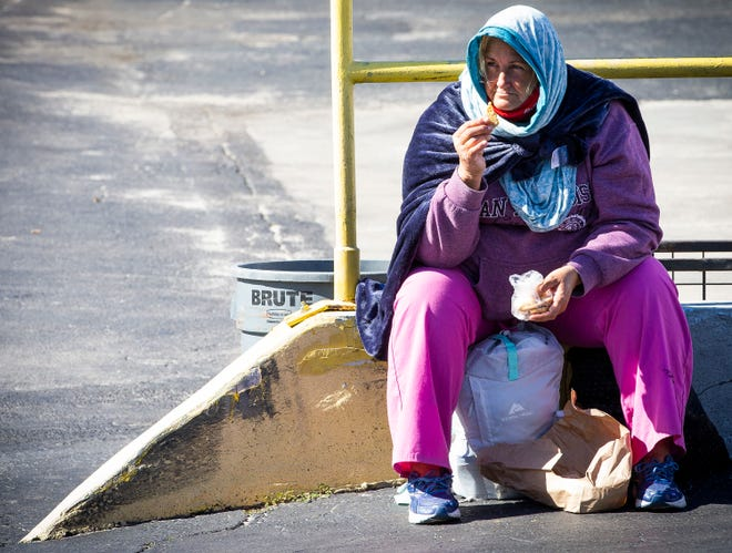 Wrapped up in a hoodie and blanket to stay warm, Beth Worthington, a homeless woman, sat outside Brother's Keeper Soup Kitchen on Dec. 1.