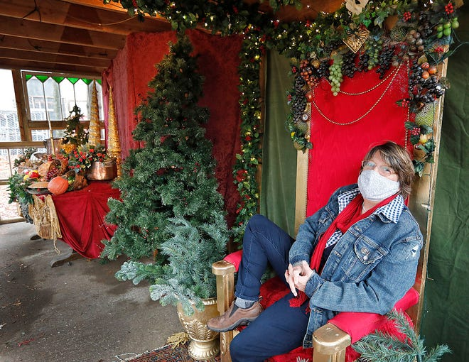 Zoe Bradford, artistic director of the Company Theatre in Norwell, sits in one of the outdoor settings for the theater's Victorian Christmas Tour.