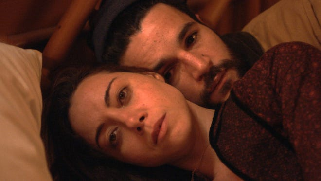 """Aubrey Plaza and Christopher Abbott appear in a scene from """"Black Bear."""""""